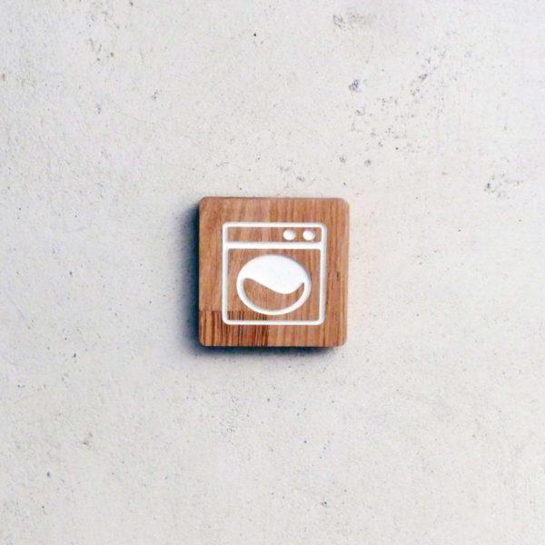 panneau buanderie avec pictogramme machine à laver