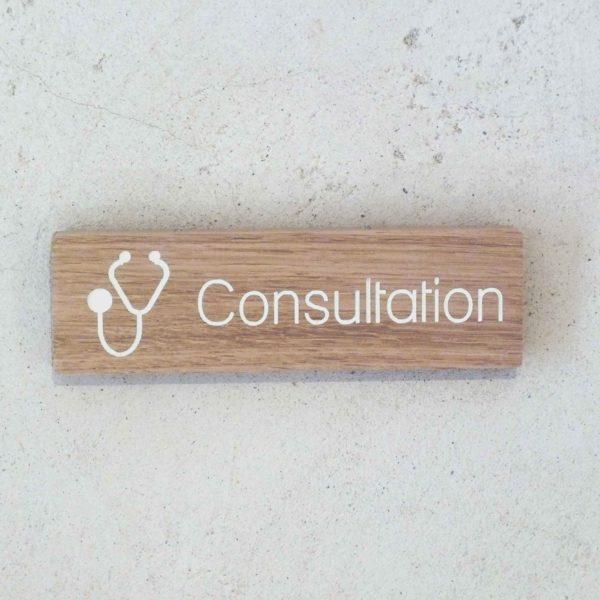panneau en bois consultation pour médecin